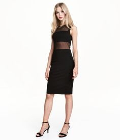 Black. Fitted, knee-length dress in thick jersey with mesh panels. Round neck, no sleeves, seam at waist, and lined skirt.