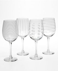 Wine Glasses. So love these! Must see. I know someone who has the super stripy one:/)) they broke the set for me at bed bath and beyond
