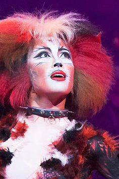 "Bombalurina Bombay Luna Role Description: [Sexy cat] is just very beautiful and attractive cat. She liked to tell jokes and adult male cat, together, we can say ""sexy cat"" is a play on behalf of a mature woman, she was under the stage lights red fur look exceptionally gorgeous and enchanting."