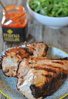 The yogurt marinade for this chicken keeps it SO moist and flavorful on the grill. Yogurt Marinated Chicken Tacos with Harissa   mountainmamacooks.com #TacoTuesday
