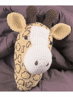 Crochet the head, add a mop/broom stick, and you have a stick giraffe!