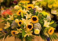 Floral Arrangement from our Paoli store #ACME #Sunflowers #Wedding