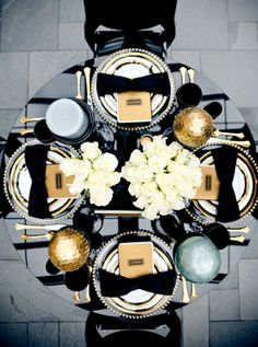We love this dramatic black and gold table-scape, complete with a black bow-shaped napkin on each plate. See more photos from Style Me Pretty Great Gatsby Themed Party, Gatsby Party, Great Gatsby Wedding, Gold Wedding Decorations, Decor Wedding, Centrepiece Wedding, Elegant Party Decorations, Black White Gold, Black And White Ribbon