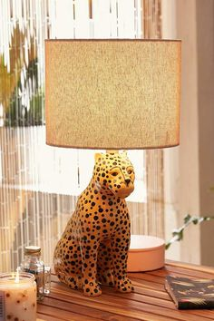 Leopard Table Lamp. Featuring a ceramic, pained base shaped like a leopard with a woven, cylindrical shade. #leoparddecor #leopards #tablelamp #afflnk #funkthishouse