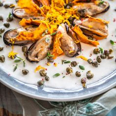 """Mussels with sweet potato chips and fried capers in cauliflower puree inspired by Wellington Chef Paul Hoather's """"Spring Scallops"""" recipe"""