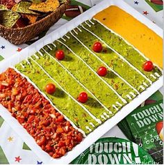 "Salsa, qucamole, cheese dip football field! Use guacamole as the playing field with salsa and nacho cheese for the end zones. Pipe on sour cream to mark the yard lines and add some cherry tomato ""players."""