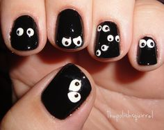 glow in the dark spooky eyes nail art for halloween!