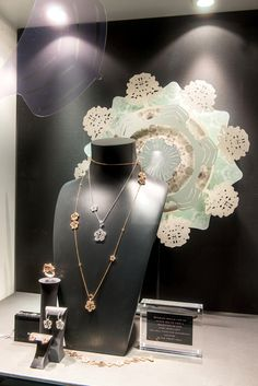 I really like the doily medallion on the back wall.  The shapes echo the shape of the jewelry. Boodles | Spring/Summer, 2013 by Millington Associates | #VM #visualmerchandising #paper