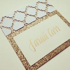 Gold metallic, a trellis white cut out, and gold calligraphy | sorority name tags.