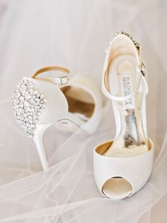 Heel embellished Badgley Mischka stilettos: http://www.stylemepretty.com/georgia-weddings/dahlonega/2016/12/22/maroon-vineyard-wedding/ Photography: Amy Arrington - http://www.amyarrington.com/