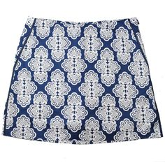 Pair this Golftini Flat Front Blue Fan Skort with blue, white or a pop of color like hot pink