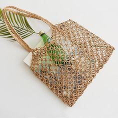 This is handbag, which is hand-woven hollowwork straw bag paper rope grid without lining woven beach bag. Suitable for travel and beach parties. Straw Handbags, Beach Tote Bags, Woven Beach Bags, Straw Tote, Types Of Bag, Girls Bags, Market Bag, Summer Bags, Handmade Bags