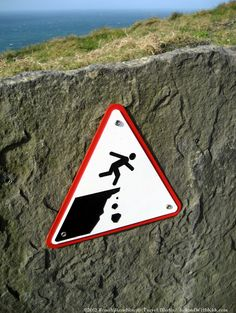 Cliffs of Moher, Co. Clare, Ireland -  Warning Sign (there's truth to this message)