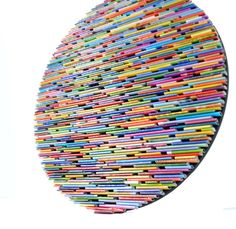 round wall art made from recycled magazines by colorstorydesigns