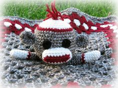 Ravelry: Sock Monkey Lovey pattern by Briana Olsen.