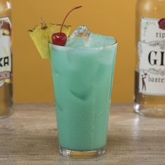 The Blue Hawaiian Long Island 🍍🍒 We combined a Long Island Iced Tea and Blue Hawaiian. This drink is potent and tropical. Iced Tea Recipes, Drinks Alcohol Recipes, Yummy Drinks, Drink Recipes, Strong Cocktails, Tea Cocktails, Peach Vodka, Peach Schnapps, Malibu Coconut