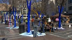 Downtown Seattle is popping with color, and not just from the spring leaves and flowers.    Volunteers helped artist Konstantin Dimopoulos paint the trees in Westlake Park blue.    He says the response, for the most part, has been positive.    The goal is to raise awareness of global deforestation.    The water-based paint is non-toxic, so it's won't hurt the trees. The blue color will eventually fade.