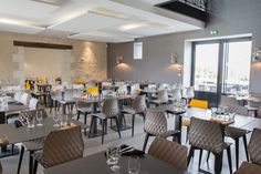 Uni-Ka Chairs from Sandler Seating at the Le Domaine De Thais Restaurant in Sorigny, France. Yellow, Hospitality, Interior, Design, Style, Office, Seating, Furniture.