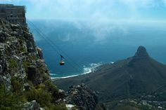 Cable car descending from Table Mountain, Lion's Head in background. Emily Riddell c. Lonely Planet Images 2011