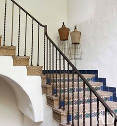 The Spanish tile in this stairway is original to the house | archdigest.com