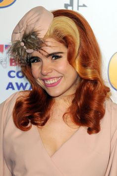 Pin for Later: Will Paloma Faith Ever Run Out of Amazing Hairstyles?  A tiny pillbox hat hid the parting on this retro curled hairstyle for the 2011 British Comedy Awards.