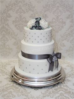 Quilted Grey and White Wedding Cake with David Austin sugar roses, privet berries and lambs ears foliage in sugar.