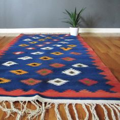 Kilim Rug.  Kilim, or urban rugs, are handmade by cooperatives employing Berber women to weave them.  The patterns and color differentiate them from Berber rugs, which are handmade by individuals and have their own patterns and dyes.