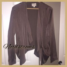 Nordstrom's silky blazer in gorgeous bronze This is a size large but was too small for me. It is a beautiful bronze silky fabric but not stretchy. It tapers down at the loose hanging pockets. Very stylish. Hinge Tops Blouses