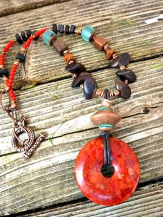 Coral pendant, leather, Greek ceramic, recycled glass,wood, stone necklace, boho jewelry    Her stuff is amazing. And it's a privilege to own her artisan wares.
