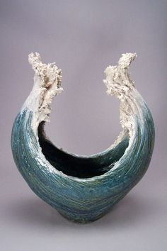 Like artists Paul DeSomma and Marsha Blaker, Denise Romecki finds inspiration for her sculptures in cresting waves. The big difference is that, while DeSomma and Blaker work with glass, Romecki creates her original pieces using stoneware clay. Requiring at least two kiln firings, her ceramic sculptures resemble beautifully rising white-capped waves that have been stunningly …