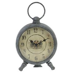 With an antiqued gray finish and traditional serif face, this vintage-inspired table clock adds a classic touch to the home office or study....