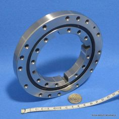 Four point contact ball slewing bearing with snap ring groove, BRS customized model BRS-XF-125T, suited for small worktable, automatic assembly lines.