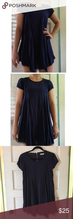 """Urban Outfitters Navy dress Navy blue dress in a small from urban Outfitters. The actual brand is silence and noise and it's only been worn once! This dress is also on the flowy side. I'm about 5""""9 and it hits me around my fingertips. silence + noise Dresses Mini"""