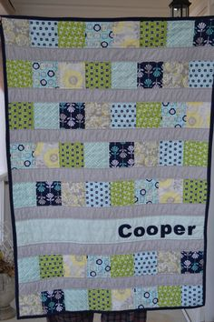 This quilt is for sale, but it would be easy enough to replicate. Based on the dimensions listed, the squares are standard charm pack size, which you could buy prepackaged (although you'd need two... there's about 1 1/3 the number in most charm packs), or cut your own.