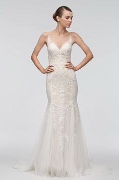 Illusion tulle and English netting rest on a stretch poly-charmeuse lining that seductively curves in this fit-and-flare wedding dress. Watters, Spring 2016