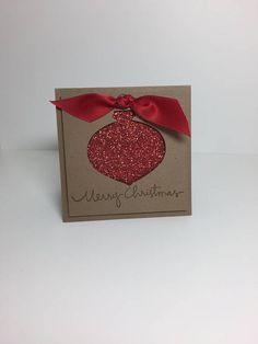 This listing is for a set of 8 hand made christmas cards. -Measures 3 inches by 3 inches -Features Stampin Up! products -All cards come with a plain white envelope for mailing unless a matching envelope is featured in the pictures -Both the card and the envelope will be shipped together in a larger envelope that will go through the USPS.