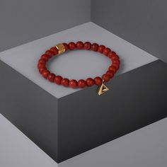Blending matte red jasper stones with a gold triangular design, the Trigonum Charm Bracelet is a sleek and stylish accessory. Available now at Northskull.com [Worldwide Shipping] #Luxury #Jewelry #MensAccessories