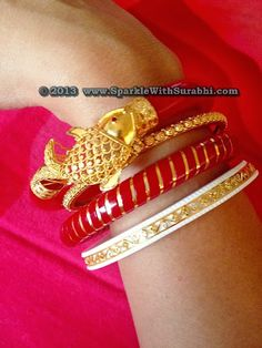 shankha pola with fish design from anjali jewellers Gold Bangles Design, Gold Earrings Designs, Designer Bangles, Bridal Jewelry, Gold Jewelry, Jewellery, Quartz Jewelry, Ethnic Jewelry, Bridal Accessories
