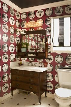 Fornasetti wallpaper  eclectic bathroom by Get Back JoJo