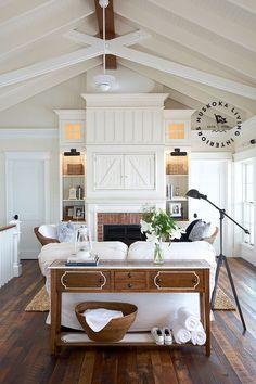 lit, built-in bookshelves in this charming family room from muskokalivinginteriors.com