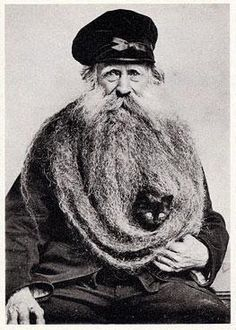 Reason # 97 to grow a beard. Louis Coulon, his eleven foot beard, and one small black cat.