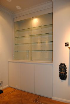 Display cabinet with glass shelves and glass sliding doors