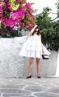 Stella Asteria wearing a little white frilled dress in Mykonos