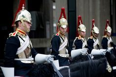 Members of the Household Calvary Mounted Regiment prepare for their royal duties as the Queens Life Guard for the Diamond Jubilee Procession.