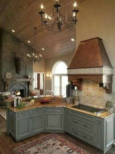 I love how this kitchen den combo flows with color.  Nothing sticks out color wise.
