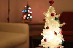 Lighting Up Tiny Trees! Tiny Christmas Trees, Christmas Lights, Christmas Ornaments, Battery Operated Lights, How To Introduce Yourself, Light Up, Sparkle, Shapes, Holiday Decor