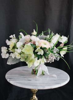 From #SarahWinward and #KateOsborne, this bouquet includes: Fritillaria, Hellebore, Dusty Miller, Ranunculus, Sweet Pea, Amnesia Rose.