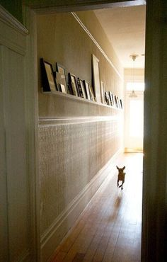 long hallway decor: love the shelf and pictures. Would be great to not nail so many holes!