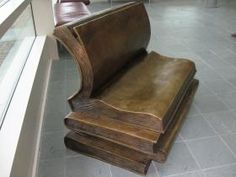 """""""Stack of Books Bench,"""" in bronze, by Randolph Rose."""