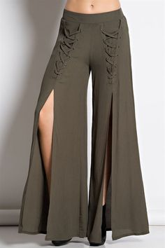 Low waist, wide leg, long pants with back elastic waistband in solid woven fabric. These rockstar palazzos feature a lace-up eyelet thigh that forks into a super high front slit streaming down to the